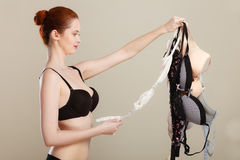 Woman choosing bras to wear Royalty Free Stock Photos