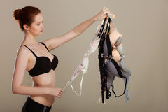 Woman choosing bras to wear Stock Photography