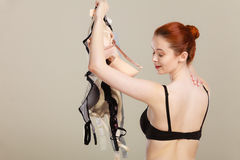 Woman choosing bras to wear Stock Images