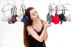 Woman choosing bras Stock Images