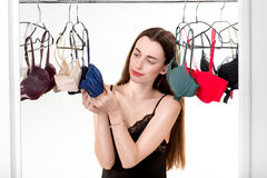 Woman choosing bras Stock Photos