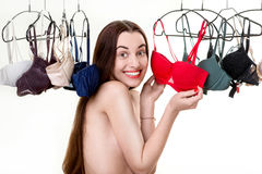 Woman choosing bras Royalty Free Stock Images