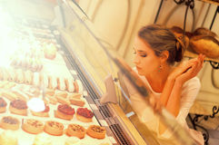 Woman choosing cakes and desserts in a cafe Stock Image