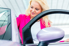Woman choosing car for buying Stock Photos