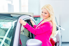 Woman choosing car for buying Stock Images