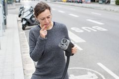 Woman choosing charger at a charging station stock images