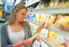 Woman choosing cheese. Royalty Free Stock Photo