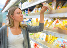 Woman choosing cheese. Stock Images