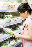 Woman choosing chinese cabbage Stock Photography