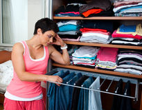 Woman choosing clothes Royalty Free Stock Photography