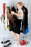 Woman Choosing Clothes Stock Photo