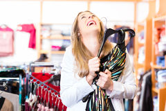 Woman choosing clothes in fashion shop Royalty Free Stock Photo