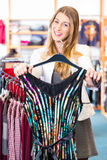 Woman choosing clothes in fashion shop Royalty Free Stock Image