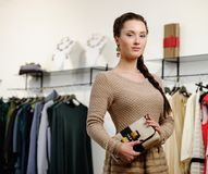 Woman choosing clothes Stock Photography