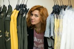 Woman choosing clothes Royalty Free Stock Photos