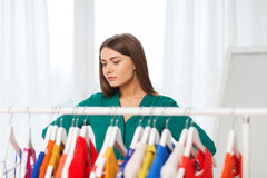 Woman choosing clothes at home wardrobe Royalty Free Stock Photography