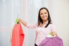Woman choosing clothes at home Royalty Free Stock Photo