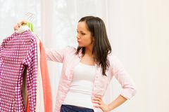 Woman choosing clothes at home Royalty Free Stock Photography