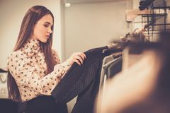 Woman choosing clothes pin a showroom Stock Photos