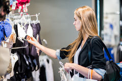 Woman choosing clothes at the shop Royalty Free Stock Photo