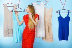 Woman choosing clothes in shop Royalty Free Stock Photo
