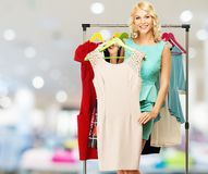 Woman choosing clothes in a shopping mall Royalty Free Stock Photography