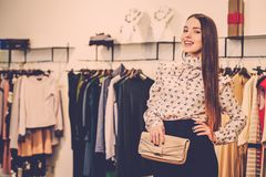 Woman choosing clothes in a showroom Stock Photos
