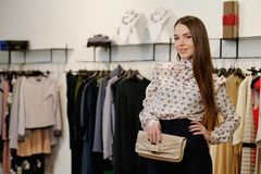 Woman choosing clothes in a showroom Royalty Free Stock Images