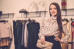 Woman choosing clothes in a showroom Royalty Free Stock Photo