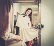 Woman choosing clothes in a showroom Royalty Free Stock Image