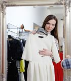 Woman choosing clothes in a showroom Royalty Free Stock Photography