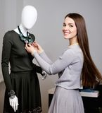 Woman choosing clothes in a showroom Stock Photography