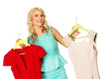 Woman choosing clothes Royalty Free Stock Images
