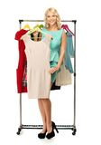 Woman choosing clothes Royalty Free Stock Image