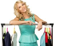 Woman choosing clothes Stock Images