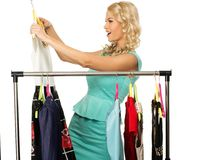 Woman choosing clothes Stock Image