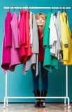 Woman choosing clothes to wear in mall or wardrobe Royalty Free Stock Photography