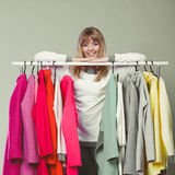 Woman choosing clothes to wear in mall or wardrobe Royalty Free Stock Image