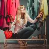 Woman choosing clothes to wear in mall or wardrobe Royalty Free Stock Photos