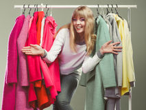 Woman choosing clothes to wear in mall or wardrobe Stock Images