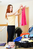 Woman choosing clothes for vacation Stock Photo