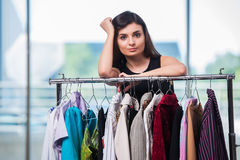 The woman choosing clothing in shop Stock Photography