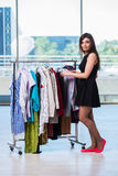 The woman choosing clothing in shop Stock Image