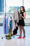 The woman choosing clothing in shop Stock Photo