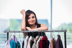 The woman choosing clothing in shop Royalty Free Stock Images