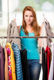 The woman choosing clothing in shop Stock Images
