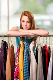 The woman choosing clothing in shop Royalty Free Stock Photos