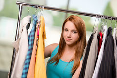 The woman choosing clothing in shop Royalty Free Stock Image