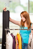 The woman choosing clothing in shop Royalty Free Stock Photo