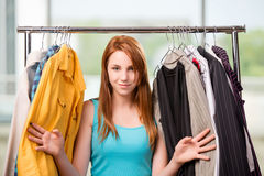 The woman choosing clothing in shop Stock Photos